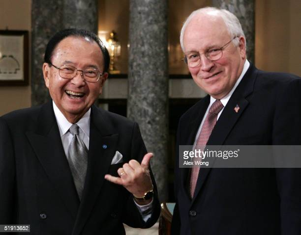 S Senator Daniel Inouye gestures as he poses for photographers with Vice President Dick Cheney during the reenactment of a swearing in ceremony...