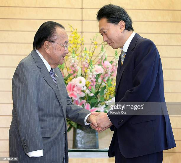 S Senator Daniel Inouye shakes hands with Japanese Prime Minister Yukio Hatoyama prior to their meeting at Hatoyama's official residence on January...
