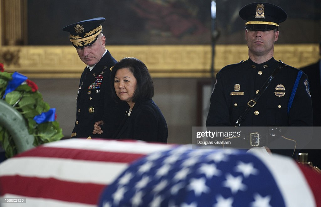 Senator Daniel Inouye's wife Irene Hirano passes by the flag is draped casket of U.S. Senator Daniel Inouye (D-HI) in the Rotunda of the U.S. Capitol where he will lie in state December 20, 2012 on Capitol Hill in Washington, DC. The late Senator had died at the age of 88 on Monday at the Walter Reed National Military Medical Center in Bethesda, Maryland where he had been hospitalized since early December. A public funeral service will be held at the Washington National Cathedral on Friday for Senator Inouye, a World War II veteran and the second-longest serving senator in history. His remains will be returned and laid to rest in his home state.