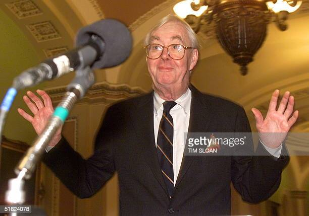 Senator Daniel Moynihan approaches the microphones to brief reporters 23 January in between attending day eight in the US Senate trial of US...
