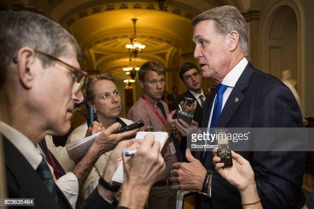 Senator David Perdue a Republican from Georgia speaks to members of the media near the Senate Subway in Washington DC US on Thursday July 27 2017...