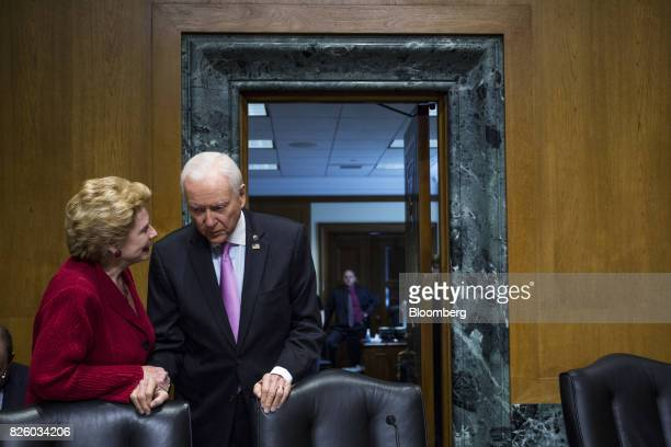 Senator Debbie Stabenow a Democrat from Michigan left speaks to Senator Orrin Hatch a Republican from Utah and chairman of the Senate Finance...