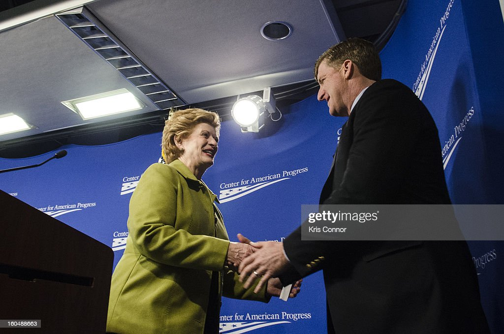 Senator Debbie Stabenow (D-MI) and Former U.S. Rep Patrick Kennedy shake hands during the 'Silver Lining Playbook' mental health progress press conference at Center For American Progress on February 1, 2013 in Washington, DC.