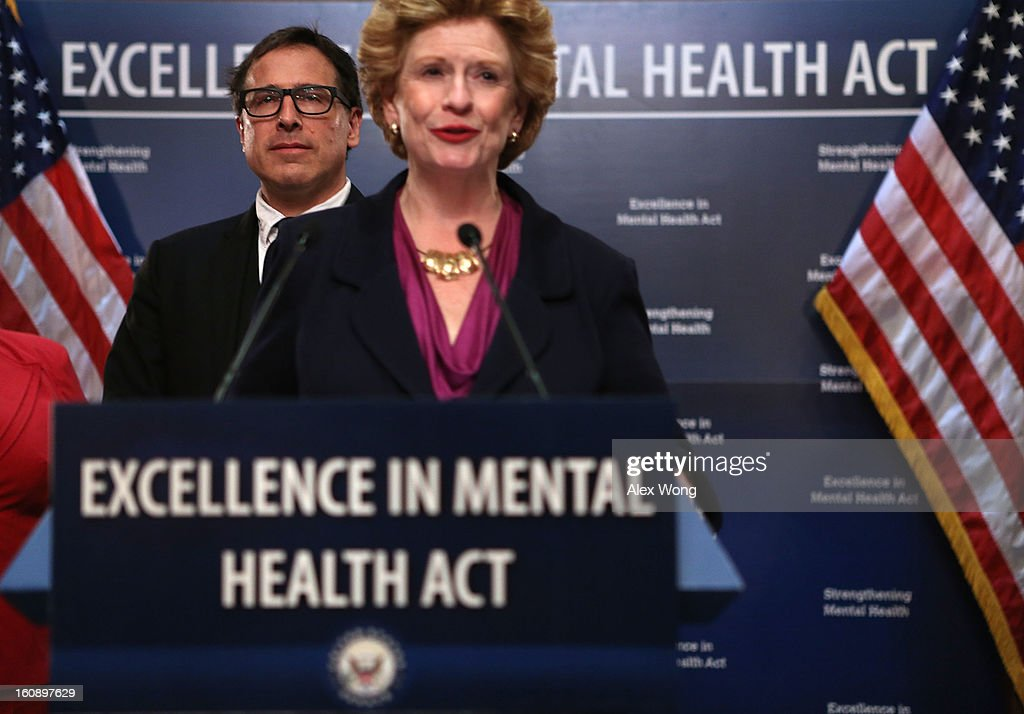 U.S. Senator <a gi-track='captionPersonalityLinkClicked' href=/galleries/search?phrase=Debbie+Stabenow&family=editorial&specificpeople=221624 ng-click='$event.stopPropagation()'>Debbie Stabenow</a> (D-MI) speaks as <a gi-track='captionPersonalityLinkClicked' href=/galleries/search?phrase=David+O.+Russell&family=editorial&specificpeople=215306 ng-click='$event.stopPropagation()'>David O. Russell</a>, director of the film Silver Linings Playbook looks on during a news conference February 7, 2013 on Capitol Hill in Washington, DC. A bipartisan group of senators will introduce the Excellence in Mental Health Act to help strengthen the nation's mental health services.