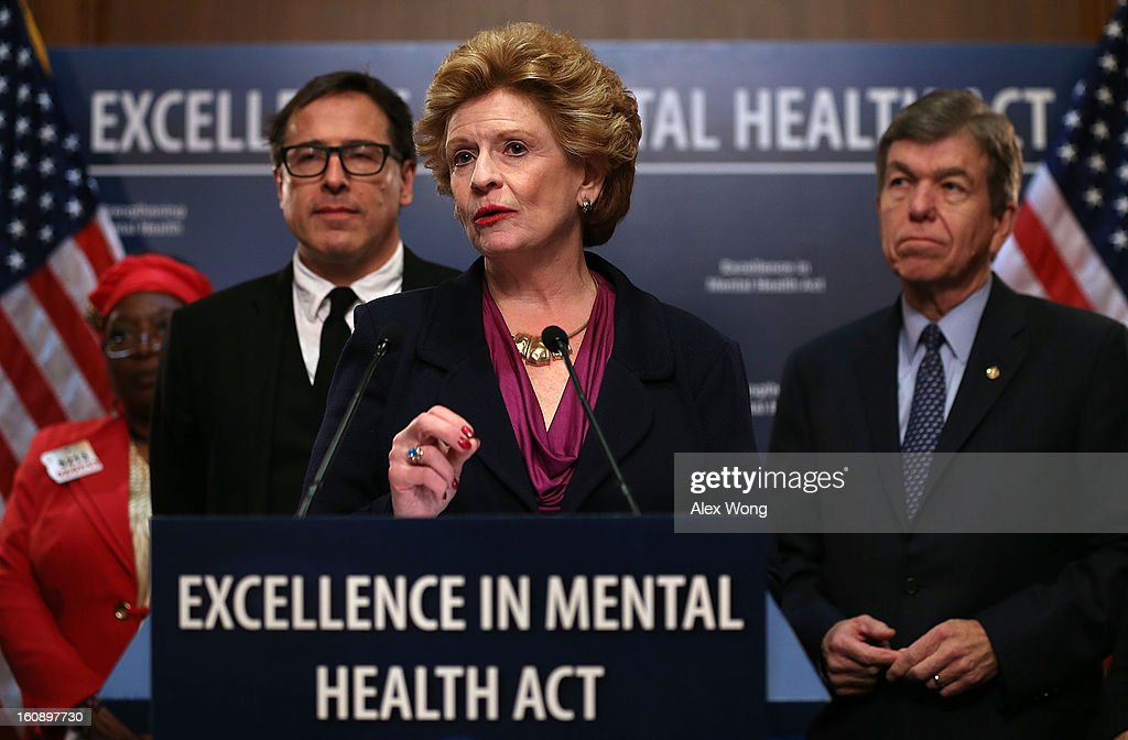 U.S. Senator <a gi-track='captionPersonalityLinkClicked' href=/galleries/search?phrase=Debbie+Stabenow&family=editorial&specificpeople=221624 ng-click='$event.stopPropagation()'>Debbie Stabenow</a> (D-MI) speaks as <a gi-track='captionPersonalityLinkClicked' href=/galleries/search?phrase=David+O.+Russell&family=editorial&specificpeople=215306 ng-click='$event.stopPropagation()'>David O. Russell</a>, director of the film Silver Linings Playbook, and Senator <a gi-track='captionPersonalityLinkClicked' href=/galleries/search?phrase=Roy+Blunt&family=editorial&specificpeople=233679 ng-click='$event.stopPropagation()'>Roy Blunt</a> (R-MO) (R) look on during a news conference February 7, 2013 on Capitol Hill in Washington, DC. A bipartisan group of senators will introduce the Excellence in Mental Health Act to help strengthen the nation's mental health services.
