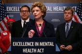 S Senator Debbie Stabenow speaks as David O Russell director of the film Silver Linings Playbook and Senator Roy Blunt look on during a news...