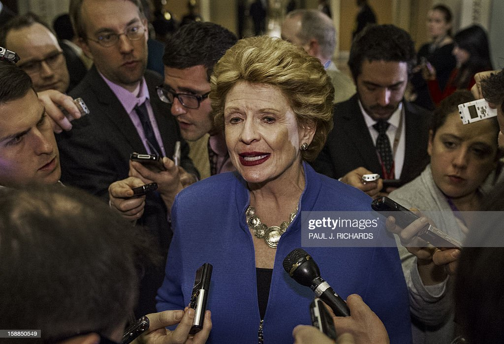US Senator Debbie Stabenow talks to reporters on the impending fiscal cliff in the hallways of the US Senate at Capitol Hill in Washington late on December 31, 2012. Coming together in the early hours of 2013, the US Senate overwhelmingly passed a last-gasp bill on January 1, 2013 to avert huge tax increases and draconian spending cuts making up the so-called 'fiscal cliff.' AFP PHOTO/Paul J. Richards