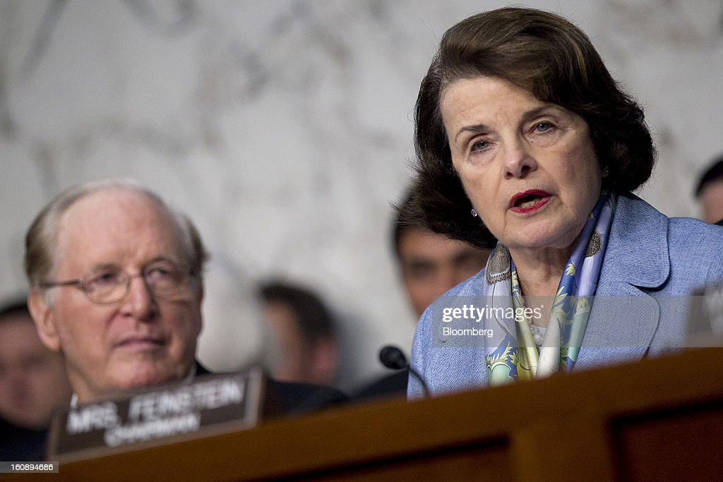 Senator <a gi-track='captionPersonalityLinkClicked' href=/galleries/search?phrase=Dianne+Feinstein&family=editorial&specificpeople=214078 ng-click='$event.stopPropagation()'>Dianne Feinstein</a>, a Democrat from California, right, chairs a Senate Select Intelligence Committee nomination hearing of John Brennan, nominee for director of the Central Intelligence Agency (CIA) and White House chief counterterrorism adviser, unseen, with Senator John Rockefeller, a Democrat from West Virginia, left, in Washington, D.C., U.S., on Thursday, Feb. 7, 2013. Protesters sought to set the tone at the confirmation hearing of John Brennan, President Barack Obama's nominee to lead the CIA, disrupting proceedings today before Brennan even spoke. Photographer: Andrew Harrer/Bloomberg via Getty Images