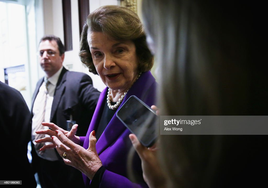 U.S. Senator <a gi-track='captionPersonalityLinkClicked' href=/galleries/search?phrase=Dianne+Feinstein&family=editorial&specificpeople=214078 ng-click='$event.stopPropagation()'>Dianne Feinstein</a> (D-CA) (C) answers questions from members of the media after she spoke on the Senate floor at the Capitol December 9, 2014 on Capitol Hill in Washington, DC. The details of a report on CIA's use of torture conducted by the Senate Intelligence Committee is expected to be released today.