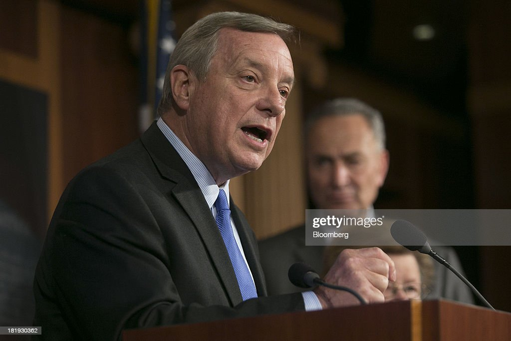 Senator <a gi-track='captionPersonalityLinkClicked' href=/galleries/search?phrase=Dick+Durbin&family=editorial&specificpeople=208219 ng-click='$event.stopPropagation()'>Dick Durbin</a>, a Democrat from Illinois, left, speaks during a news conference with Senator Charles 'Chuck' Schumer, a Democrat from New York, in Washington, D.C., U.S., on Thursday, Sept. 26, 2013. The Senate is accelerating debate on a bill that would avert a U.S. government shutdown as Senate Republicans sought to buy time for their House counterparts to take another swipe at President Barack Obama's health-care law. Photographer: Andrew Harrer/Bloomberg via Getty Images