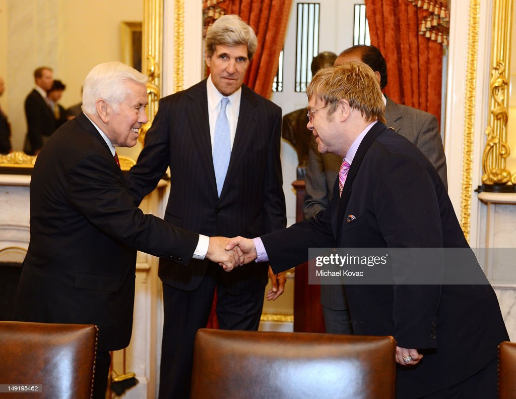 U.S. Senator Dick Lugar (R-IN), U.S. Senator <a gi-track='captionPersonalityLinkClicked' href=/galleries/search?phrase=John+Kerry&family=editorial&specificpeople=154885 ng-click='$event.stopPropagation()'>John Kerry</a> (D-MA), and Sir <a gi-track='captionPersonalityLinkClicked' href=/galleries/search?phrase=Elton+John&family=editorial&specificpeople=171369 ng-click='$event.stopPropagation()'>Elton John</a> meet after The <a gi-track='captionPersonalityLinkClicked' href=/galleries/search?phrase=Elton+John&family=editorial&specificpeople=171369 ng-click='$event.stopPropagation()'>Elton John</a> AIDS Foundation and UNAIDS breakfast at the Russell Senate Office Building on July 24, 2012 in Washington, DC.