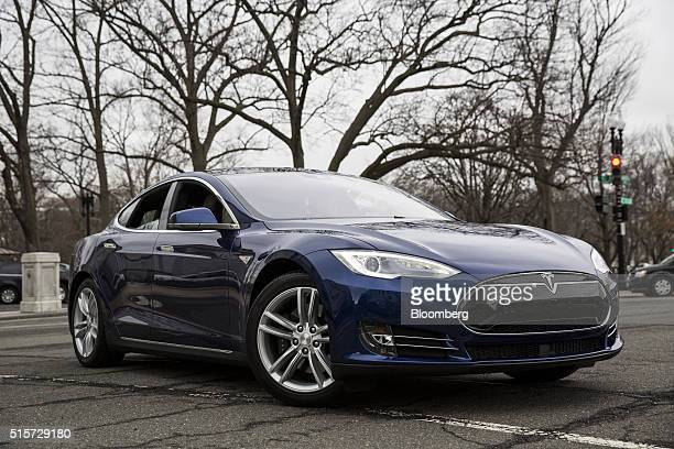 Senator Edward 'Ed' Markey a Democrat from Massachusetts seated inside the car takes a ride in a Tesla Motors Inc Model S 90D a model with some...