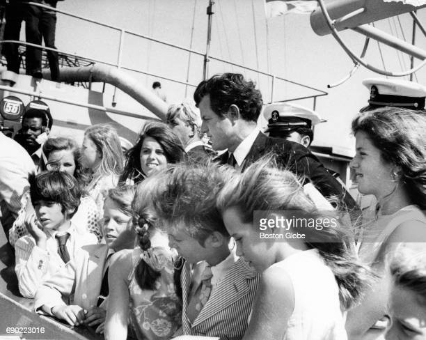 Senator Edward M Kennedy is surrounded by various members of the Kennedy family on the USS John F Kennedy as the aircraft carrier visits Boston for...