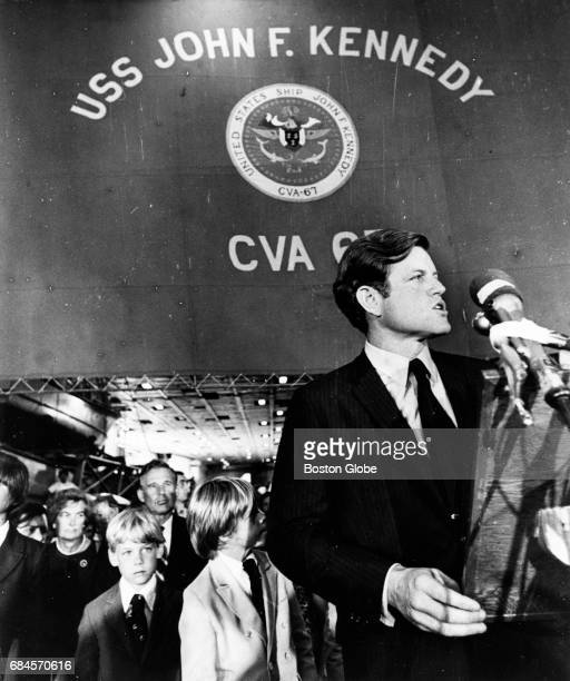 Senator Edward M Kennedy speaks to the crew of the USS John F Kennedy as the aircraft carrier visits Boston for the time on Aug 3 before leaving for...