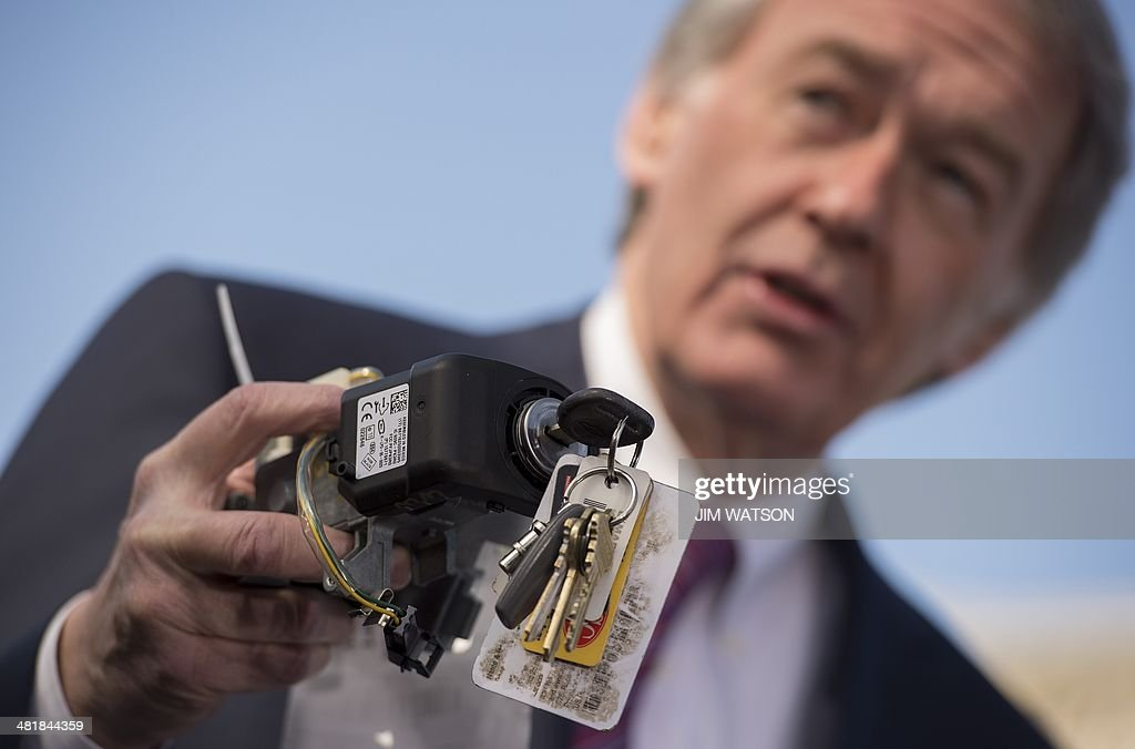 US Senator Edward Markey DMassachusetts holds up a faulty General Motors ignition switch during a press conference with the family members of...