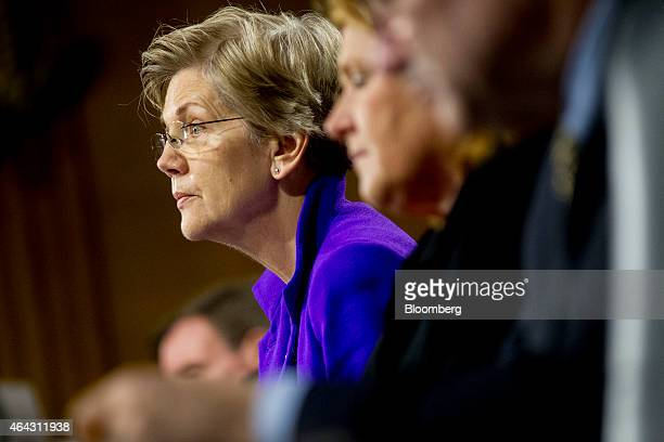 Senator Elizabeth Warren a Democrat from Massachusetts from left Senator Heidi Heitkamp a Democrat from North Dakota and Senator Joe Donnelly a...