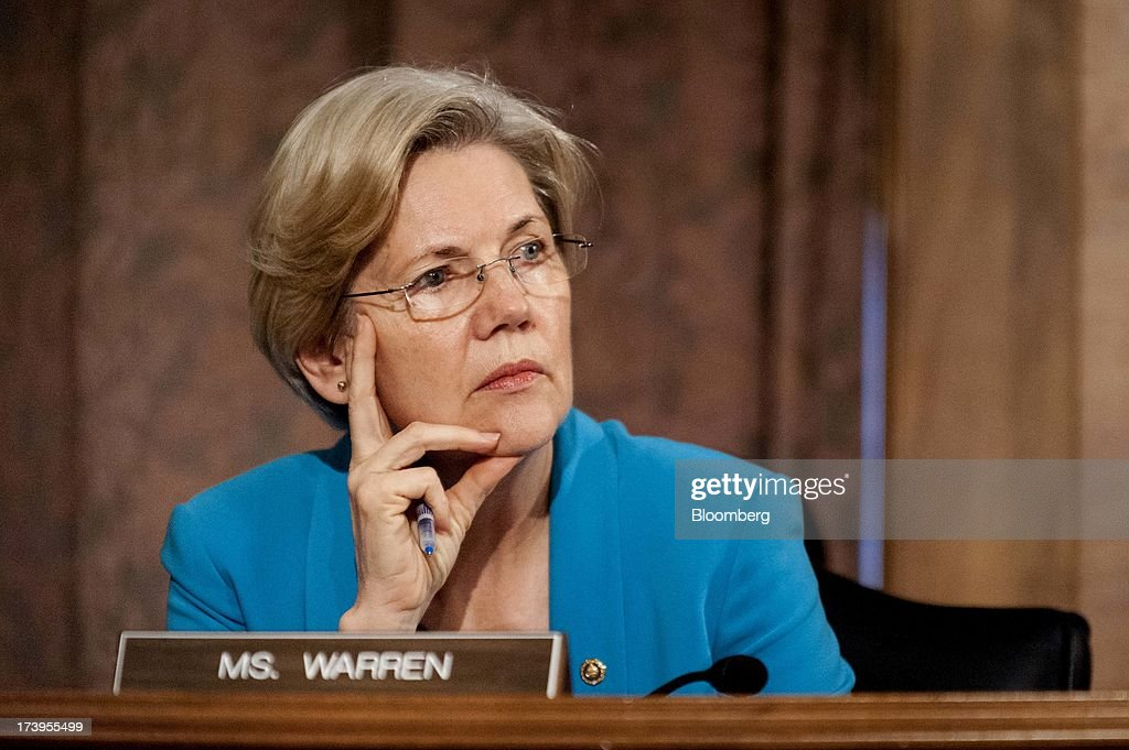 Senator <a gi-track='captionPersonalityLinkClicked' href=/galleries/search?phrase=Elizabeth+Warren&family=editorial&specificpeople=5396017 ng-click='$event.stopPropagation()'>Elizabeth Warren</a>, a Democrat from Massachusetts, listens as Ben S. Bernanke, chairman of the U.S. Federal Reserve, not seen, answers a question during his semi-annual monetary policy report to the Senate Banking, Housing and Urban Affairs Committee during a hearing on Capitol Hill, in Washington, D.C., U.S., on Thursday, July 18, 2013. Bernanke said one reason for the recent rise in long-term interest rates is the unwinding of leveraged and 'excessively risky' investing. Photographer: Pete Marovich/Bloomberg via Getty Images