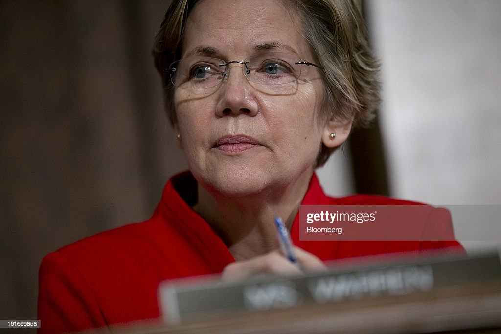Senator <a gi-track='captionPersonalityLinkClicked' href=/galleries/search?phrase=Elizabeth+Warren&family=editorial&specificpeople=5396017 ng-click='$event.stopPropagation()'>Elizabeth Warren</a>, a Democrat from Massachusetts, listens during a Senate Banking Committee hearing in Washington, D.C., U.S., on Thursday, Feb. 14, 2013. U.S. regulators told lawmakers they are making significant progress to prevent a repeat of the 2008 credit crisis, pushing back against complaints of slow progress and efforts to undo parts of the Dodd-Frank Act. Photographer: Andrew Harrer/Bloomberg via Getty Images