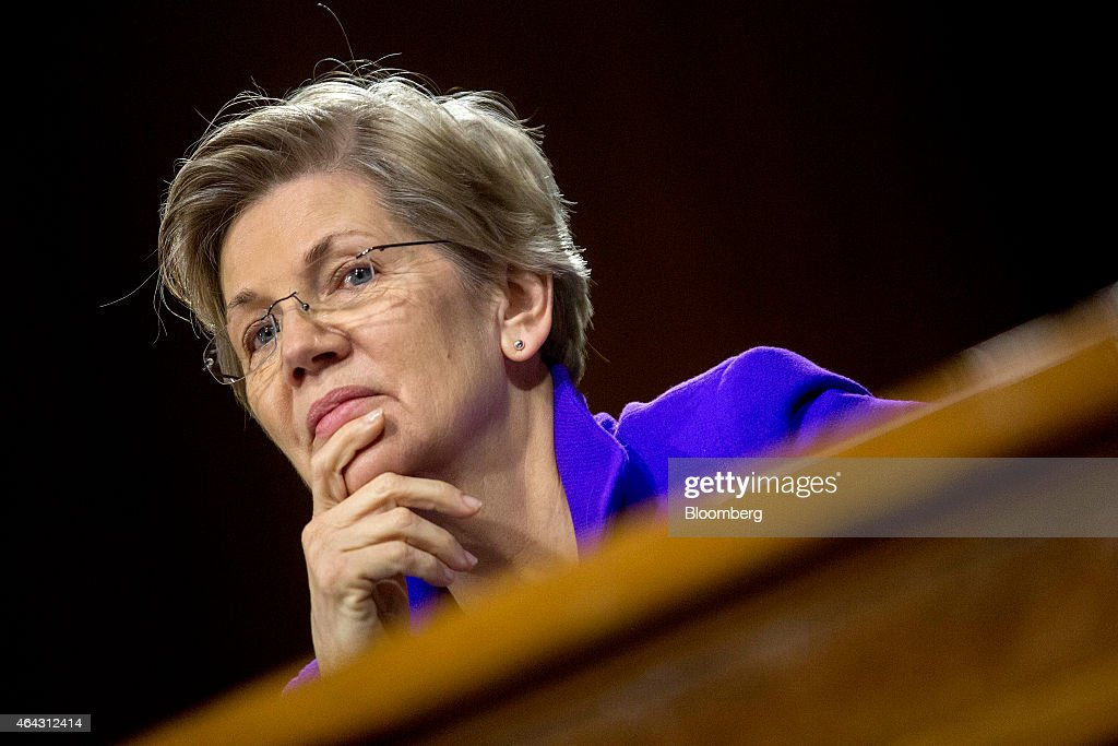 Senator Elizabeth Warren, a Democrat from Massachusetts, listens during a Senate Banking Committee hearing with Janet Yellen, chair of the U.S. Federal Reserve, not pictured, in Washington, D.C., U.S., on Tuesday, Feb. 24, 2015. Yellen said inflation and wage growth remain too low even as the job market improves, and she signaled that a change in the Fed's guidance on interest rates won't lock it into a timetable for tightening. Photographer: Andrew Harrer/Bloomberg via Getty Images
