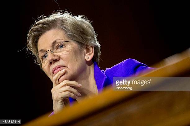 Senator Elizabeth Warren a Democrat from Massachusetts listens during a Senate Banking Committee hearing with Janet Yellen chair of the US Federal...