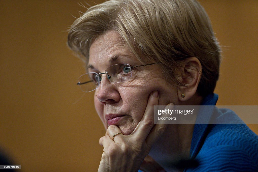 Senator <a gi-track='captionPersonalityLinkClicked' href=/galleries/search?phrase=Elizabeth+Warren&family=editorial&specificpeople=5396017 ng-click='$event.stopPropagation()'>Elizabeth Warren</a>, a Democrat from Massachusetts, listens during a Senate Banking Committee hearing with Janet Yellen, chair of the U.S. Federal Reserve, not pictured, in Washington, D.C., U.S., on Thursday, Feb. 11, 2016. Yellen said the Fed was taking another look at negative interest rates as a potential policy tool if the U.S. economy faltered, a scenario some investors view as a mounting possibility amid a darkening outlook for world growth. Photographer: Andrew Harrer/Bloomberg via Getty Images