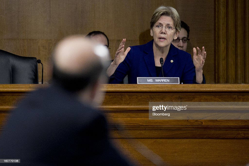Senator <a gi-track='captionPersonalityLinkClicked' href=/galleries/search?phrase=Elizabeth+Warren&family=editorial&specificpeople=5396017 ng-click='$event.stopPropagation()'>Elizabeth Warren</a>, a Democrat from Massachusetts, questions Ben S. Bernanke, chairman of the U.S. Federal Reserve, left, listens during a Senate Banking Committee hearing in Washington, D.C., U.S., on Tuesday, Feb. 26, 2013. Bernanke defended the central bank's unprecedented asset purchases, saying they are supporting the expansion with little risk of inflation or asset-price bubbles. Photographer: Andrew Harrer/Bloomberg via Getty Images