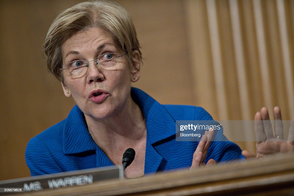Senator <a gi-track='captionPersonalityLinkClicked' href=/galleries/search?phrase=Elizabeth+Warren&family=editorial&specificpeople=5396017 ng-click='$event.stopPropagation()'>Elizabeth Warren</a>, a Democrat from Massachusetts, questions Janet Yellen, chair of the U.S. Federal Reserve, not pictured, during a Senate Banking Committee hearing with in Washington, D.C., U.S., on Thursday, Feb. 11, 2016. Yellen said the Fed was taking another look at negative interest rates as a potential policy tool if the U.S. economy faltered, a scenario some investors view as a mounting possibility amid a darkening outlook for world growth. Photographer: Andrew Harrer/Bloomberg via Getty Images