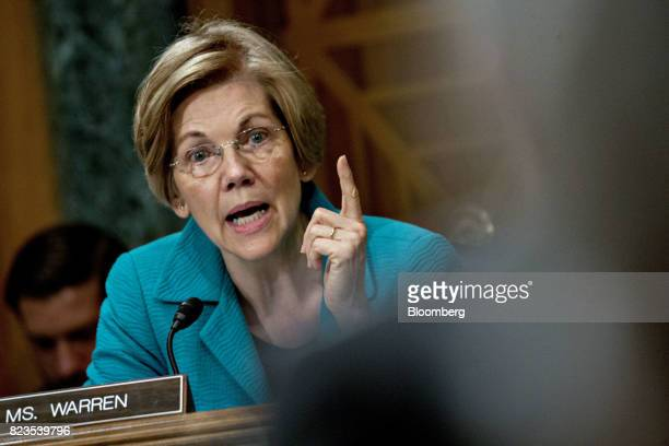 Senator Elizabeth Warren a Democrat from Massachusetts questions Randal Quarles governor of the US Federal Reserve nominee for US President Donald...