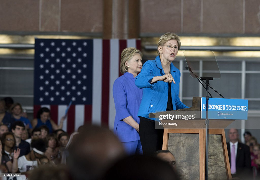 Senator Elizabeth Warren, a Democrat from Massachusetts, right, speaks as <a gi-track='captionPersonalityLinkClicked' href=/galleries/search?phrase=Hillary+Clinton&family=editorial&specificpeople=76480 ng-click='$event.stopPropagation()'>Hillary Clinton</a>, former Secretary of State and presumptive Democratic presidential nominee, listens during a campaign event in Cincinnati, Ohio, U.S., on Monday, June 27, 2016. Clinton released a new national television ad on Sunday attacking likely Republican rival Donald Trump for his comments on the U.K's decision to leave the European Union, and later warned of the negative impact that 'bombastic' behavior can have at times of crisis. Photographer: Ty Wright/Bloomberg via Getty Images