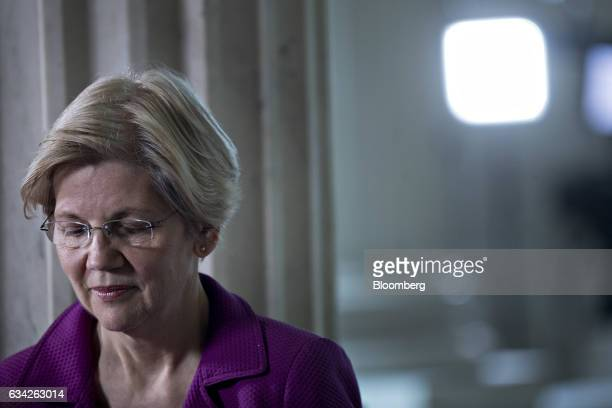 Senator Elizabeth Warren a Democrat from Massachusetts waits to participate in a television interview in the Russell Senate Office building rotunda...