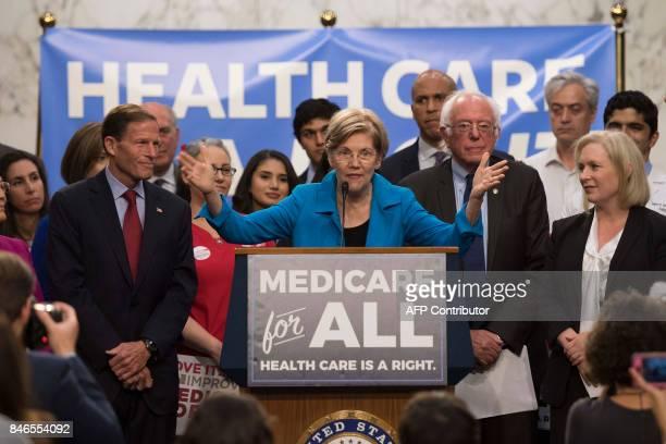 US Senator Elizabeth Warren Democrat from Massachusetts speaks with US Senator Bernie Sanders Independent from Vermont as they discusses Medicare for...
