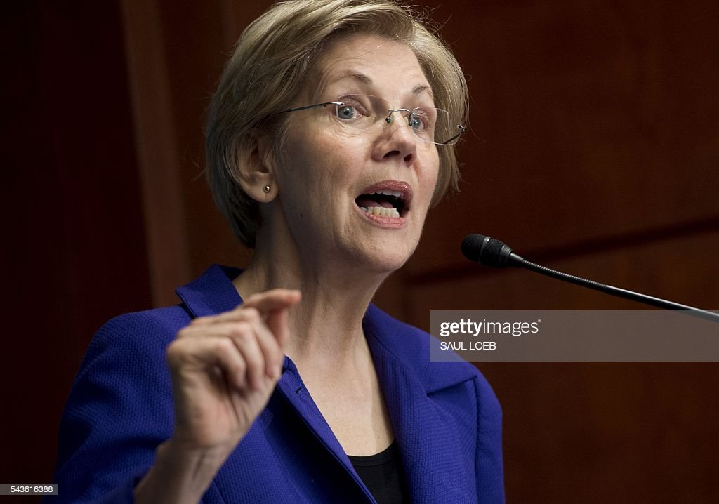 Senator Elizabeth Warren, Democrat of Massachusetts, speaks about open markets and monopolies in the US economy during the New America's Open Market Program on Capitol Hill in Washington, DC, June 29, 2016. / AFP / SAUL