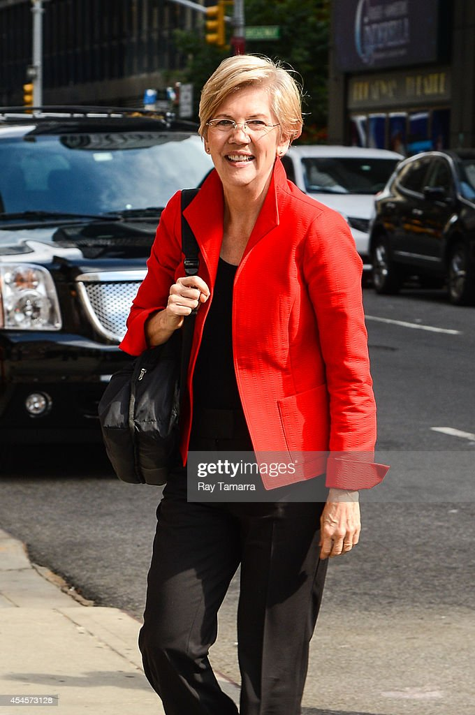 Senator Elizabeth Warren (D-MA) enters the 'Late Show With David Letterman' taping at the Ed Sullivan Theater on September 3, 2014 in New York City.