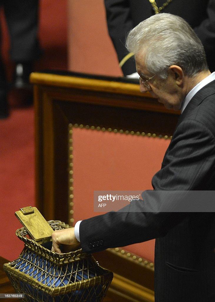 Senator for life Mario Monti casts his ballot during the first session of the senate on March 15, 2013 in Rome. General election in Italy took place on February 26 but as a majority in both chambers of parliament is required to form a government, Italy is left in a state of limbo with a hung parliament that is unprecedented in its post-war history.
