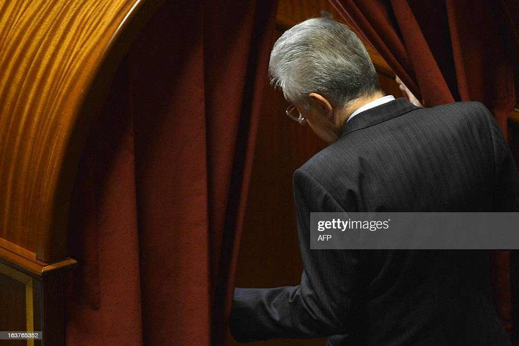 Senator for life Mario Monti enters the voting booth during the first session of the senate on March 15, 2013 in Rome. General election in Italy took place on February 26 but as a majority in both chambers of parliament is required to form a government, Italy is left in a state of limbo with a hung parliament that is unprecedented in its post-war history. AFP PHOTO / ALBERTO LINGRIA