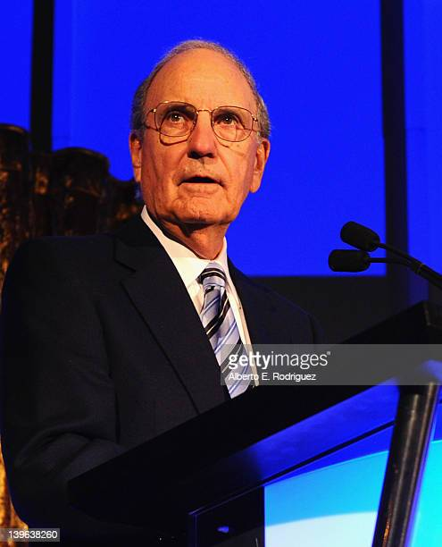 Senator George Mitchell speaks onstage at the 7th Annual 'Oscar Wilde Honoring The Irish In Film' PreAcademy Awards Event at Bad Robot on February 23...