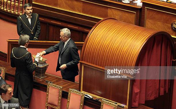 Senator Giulio Tremonti votes for the president of Senate during the Italian Parliament inaugural session at Senate on March 15 2013 in Rome Italy...