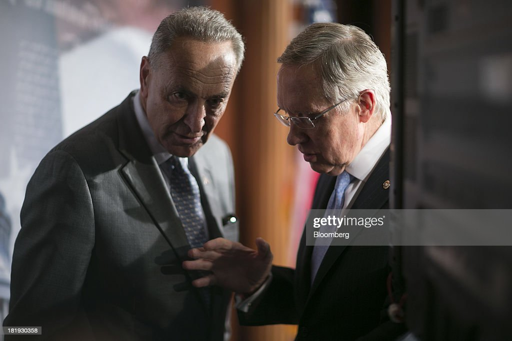 Senator <a gi-track='captionPersonalityLinkClicked' href=/galleries/search?phrase=Harry+Reid+-+Politician&family=editorial&specificpeople=203136 ng-click='$event.stopPropagation()'>Harry Reid</a>, a Democrat from Nevada and Senate majority leader, right, talks to Senator Charles 'Chuck' Schumer, a Democrat from New York, following a news conference in Washington, D.C., U.S., on Thursday, Sept. 26, 2013. The Senate is accelerating debate on a bill that would avert a U.S. government shutdown as Senate Republicans sought to buy time for their House counterparts to take another swipe at President Barack Obama's health-care law. Photographer: Andrew Harrer/Bloomberg via Getty Images