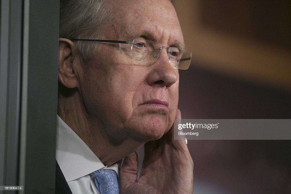Senator <a gi-track='captionPersonalityLinkClicked' href=/galleries/search?phrase=Harry+Reid+-+Politician&family=editorial&specificpeople=203136 ng-click='$event.stopPropagation()'>Harry Reid</a>, a Democrat from Nevada and Senate majority leader, listens during a news conference in Washington, D.C., U.S., on Thursday, Sept. 26, 2013. The Senate is accelerating debate on a bill that would avert a U.S. government shutdown as Senate Republicans sought to buy time for their House counterparts to take another swipe at President Barack Obama's health-care law. Photographer: Andrew Harrer/Bloomberg via Getty Images