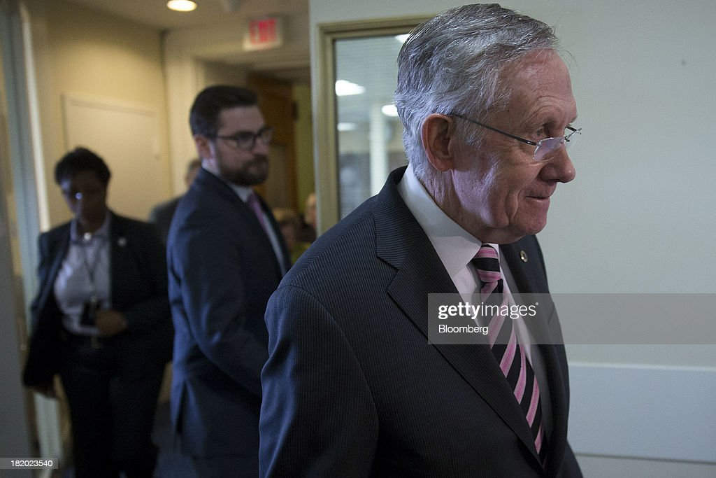 Senator <a gi-track='captionPersonalityLinkClicked' href=/galleries/search?phrase=Harry+Reid+-+Politician&family=editorial&specificpeople=203136 ng-click='$event.stopPropagation()'>Harry Reid</a>, a Democrat from Nevada and Senate majority leader, arrives to a news conference following a vote in Washington, D.C., U.S., on Friday, Sept. 27, 2013. The U.S. Senate voted to finance the government through Nov. 15 after removing language to choke off funding for the health care law, putting pressure on the House to avoid a federal shutdown set to start Oct. 1. Photographer: Andrew Harrer/Bloomberg via Getty Images