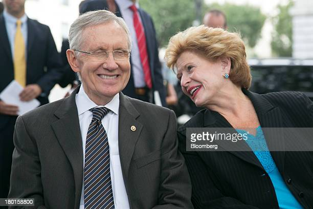 Senator Harry Reid a Democrat from Nevada left laughs with Senator Debbie Stabenow a Democrat from Michigan at a news conference sponsored by the...