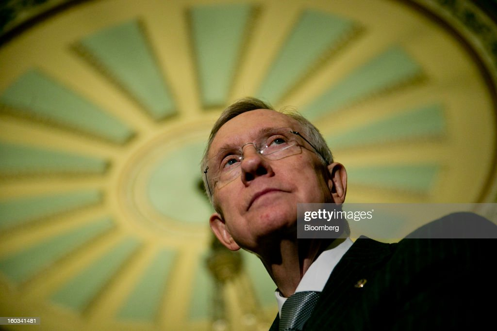 Senator <a gi-track='captionPersonalityLinkClicked' href=/galleries/search?phrase=Harry+Reid+-+Politician&family=editorial&specificpeople=203136 ng-click='$event.stopPropagation()'>Harry Reid</a>, a Democrat from Nevada, listens to a question during a news conference after the weekly Democratic Policy Committee meeting in Washington, D.C., U.S., on Tuesday, Jan. 29, 2013. President Barack Obama sought to build on gathering political momentum for sweeping revisions to the nation's immigration laws, giving cautious endorsement to a new Senate blueprint and offering more details of his own plan. Photographer: Andrew Harrer/Bloomberg via Getty Images