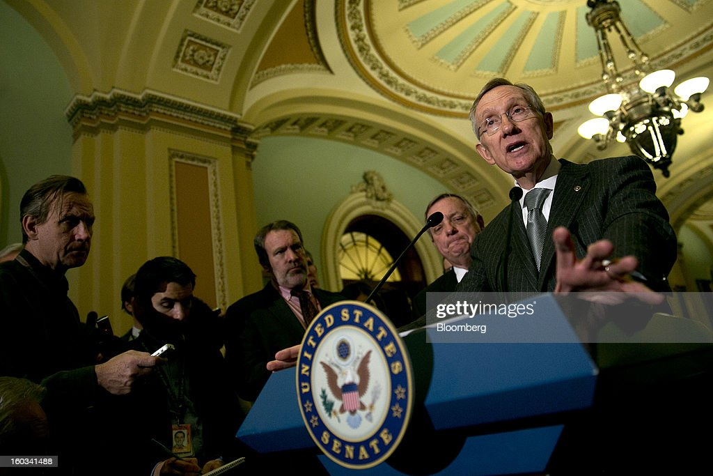 Senator <a gi-track='captionPersonalityLinkClicked' href=/galleries/search?phrase=Harry+Reid+-+Politician&family=editorial&specificpeople=203136 ng-click='$event.stopPropagation()'>Harry Reid</a>, a Democrat from Nevada, right, speaks during a news conference after the weekly Democratic Policy Committee meeting with Senator Richard Durbin, a Democrat from Illinois, center, in Washington, D.C., U.S., on Tuesday, Jan. 29, 2013. President Barack Obama sought to build on gathering political momentum for sweeping revisions to the nation's immigration laws, giving cautious endorsement to a new Senate blueprint and offering more details of his own plan. Photographer: Andrew Harrer/Bloomberg via Getty Images