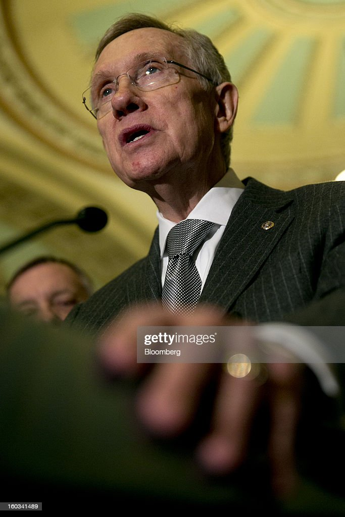 Senator <a gi-track='captionPersonalityLinkClicked' href=/galleries/search?phrase=Harry+Reid+-+Politician&family=editorial&specificpeople=203136 ng-click='$event.stopPropagation()'>Harry Reid</a>, a Democrat from Nevada, speaks during a news conference after the weekly Democratic Policy Committee meeting in Washington, D.C., U.S., on Tuesday, Jan. 29, 2013. President Barack Obama sought to build on gathering political momentum for sweeping revisions to the nation's immigration laws, giving cautious endorsement to a new Senate blueprint and offering more details of his own plan. Photographer: Andrew Harrer/Bloomberg via Getty Images