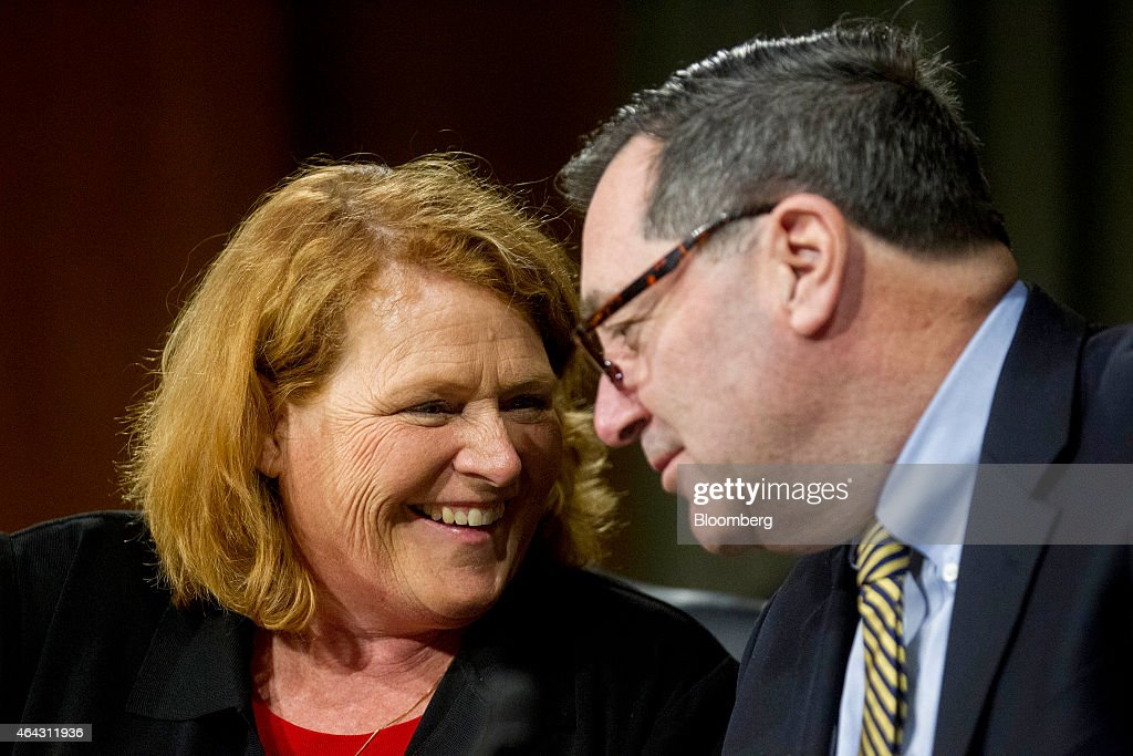 Senator <a gi-track='captionPersonalityLinkClicked' href=/galleries/search?phrase=Heidi+Heitkamp&family=editorial&specificpeople=9983176 ng-click='$event.stopPropagation()'>Heidi Heitkamp</a>, a Democrat from North Dakota, left, talks to Senator <a gi-track='captionPersonalityLinkClicked' href=/galleries/search?phrase=Joe+Donnelly&family=editorial&specificpeople=3269744 ng-click='$event.stopPropagation()'>Joe Donnelly</a>, a Democrat from Indiana, during a Senate Banking Committee hearing with Janet Yellen, chair of the U.S. Federal Reserve, not pictured, in Washington, D.C., U.S., on Tuesday, Feb. 24, 2015. Yellen said inflation and wage growth remain too low even as the job market improves, and she signaled that a change in the Fed's guidance on interest rates won't lock it into a timetable for tightening. Photographer: Andrew Harrer/Bloomberg via Getty Images
