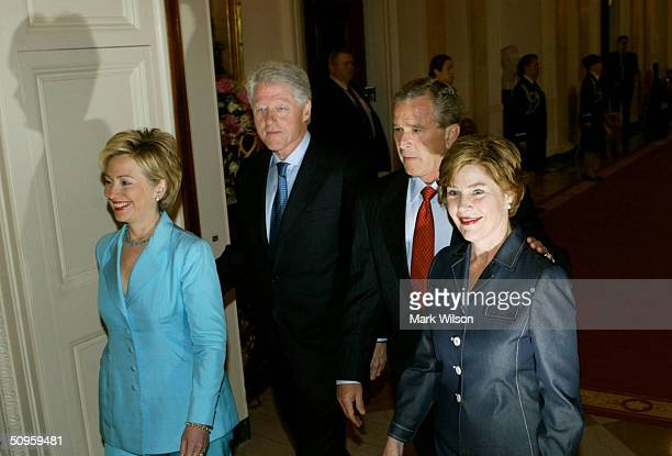 US Senator Hillary Clinton her husband former US President Bill Clinton US President George W Bush and first lady Laura Bush arrive at a ceremony to...