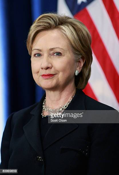 Senator Hillary Clinton listens as Presidentelect Barack Obama introduces her as his choice for secretary of state during a press conference at the...