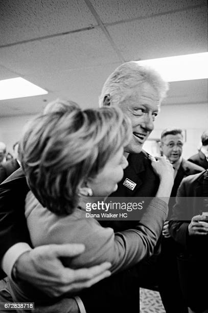 Senator Hillary Rodham Clinton and Former President William Clinton are photographed hugging after Hillary accepts her party's unanimous nomination...