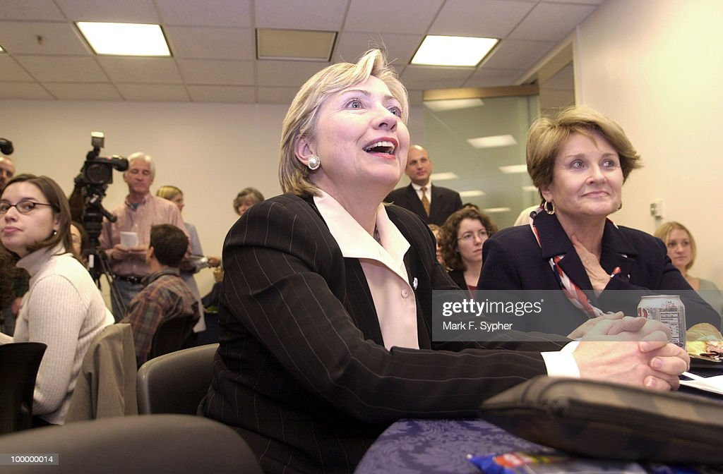Senator Hillary Rodham Clinton (D-NY) laughing at a joke told by Rep. Juanita Millender-McDonald (D-CA), who headed the presentation for the ribute of the brave women who have worked so hard at Ground Zero and other places dince the 9-11 attack on America.