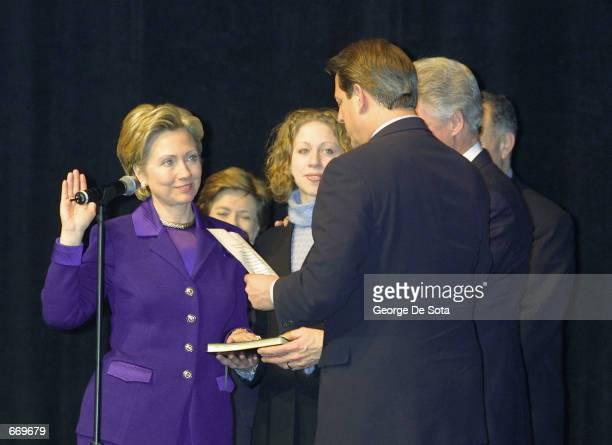 Senator Hillary Rodham Clinton left reenacts her senatorial swearingin January 7 2001 at an event at Madison Square Garden in New York Giving Clinton...